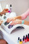 Woman hand on manicure treatment in beauty salon. Beauty parlour