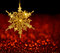 Gold Snowflake on Red Blur Background