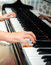 Hands of pianist performing on classical piano