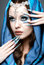 Beautiful girl in eastern Arabic image with long nails and bright blue make-up.