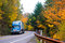 Blue semi truck on winding highway in autumn Columbia Gorge