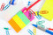 Multicolored office stationery on white desktop closeup