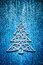 Christmas toys simbol of fir tree on blue background