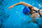 Female swimmer in an indoor swimming pool - doing crawl