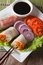 Vegetable spring rolls with sauce vertical top view closeup