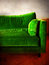 Green retro sofa in a room