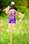 Dressed scarecrow for decoration in a green spring garden