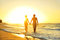 Romantic honeymoon couple in love at beach sunset