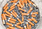 Many cigarette ends in plastic pot