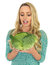 Young Woman Holding a Raw Uncooked Savoy Cabbage