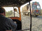 Driver of an auto rickshaw taxis on a road