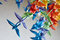 Colorful handmade origami cranes or fantasy birds