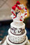 Wedding cake with a bride and groom topper
