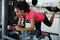 Young athletic girl working out at gym doing exercise for buttocks and legs