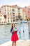 Woman travel tourist with camera and map in Venice