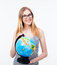 Young girl in glasses holding world globe