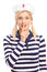 Woman in sailor outfit holding finger on her lips