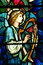 An angel making music in stained glass
