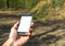 Hand Holding Mobile Phone with White Screen