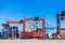 Landscape of truck, containers and crane at trade port