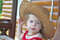 Baby girl wearing straw hat