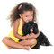 Cute small girl kissing her pet dog