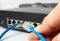 LAN network switch with ethernet cables plugging in