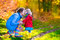 Mother and child playing in an autumn park