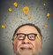 Thinking elderly man with question signs and light idea bulb above head