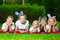 Happy children lying on green grass outdoors in