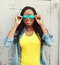 Happy smiling african woman in colorful clothes and sunglasses