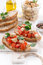 Toasts with tomatoes and marinated feta, vertical