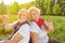 Senior couple holding thumbs up in summer vacation