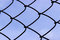 Wired fence on a sky background