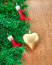Artificial Christmas tree, electric candles and golden heart