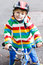 Cute active little boy riding on bike