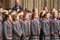 Children choir singing Christmas carols in front of the Bath Abbey
