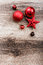 Red Christmas ornaments on a rustic wooden background
