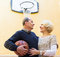 Mature couple playing basketball in patio