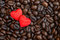 Red satin hearts on coffee beans, valentines or mothers day background, love celebrating