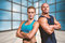 Composite image of portrait of confident strong man and woman