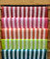 Colorful Red, Pink, Orange, Green and Blue Stripe Pattern Paper on Wooden Shelf for DIY Work
