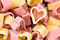 Red and yellow heart shaped pasta, top view, food background, cl