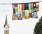 Church tower and decorative festive flags in Keszthely, Hungary, cultural event