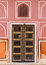 Old door in palace with pink walls in Jaipur, India