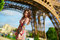 Beautiful woman walking in Paris under the Eiffel tower on a nice spring or summer day