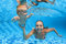 Child swimming lesson - baby with moher dive underwater in pool