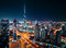 Fantastic rooftop view of Dubai\'s modern architecture by night