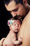 Young bearded father gently holds on his chest  newborn baby daughter