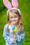 Beautiful smiling little girl wearing pink rabbit or bunny ears